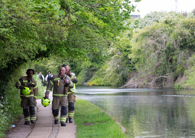Emergency services on the Grand Union Canal near Old Oak Lane in north west London where the baby was found. Photo: David Parry/PA Wire