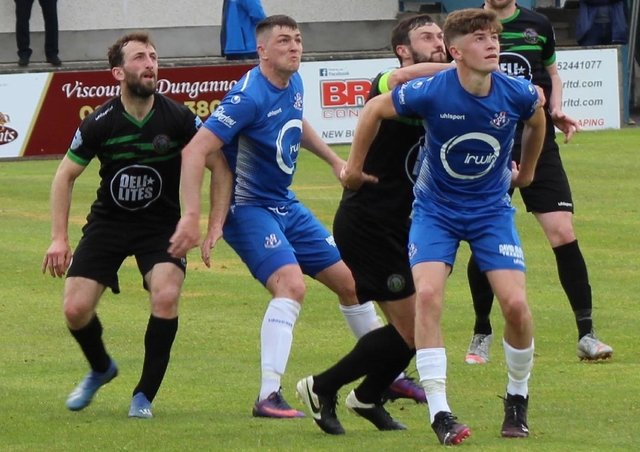 Loughgall defender John Scott (right) keeping his focus to help secure Saturday's Irish Cup win. Pic courtesy of Loughgall FC.