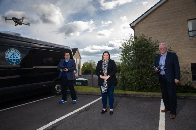 Communities Minister Deirdre Hargey with Director of Crowded Space Drones, Andrew McQuillan and Crowded Space Drones' Business Development Manager, Stephen Mills