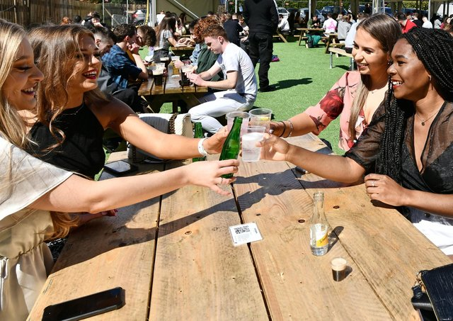 Customers enjoy a drink outdoors at the Botanic Inn, Belfast after the recent reopening of outdoor hospitality