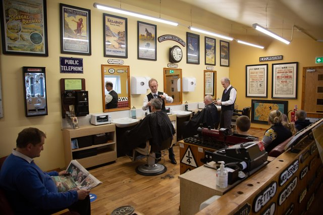 The Johnston Brothers photographed pre-lockdown in their Barbershop-Museum. L-R. Selwyn, Nigel and Gordon