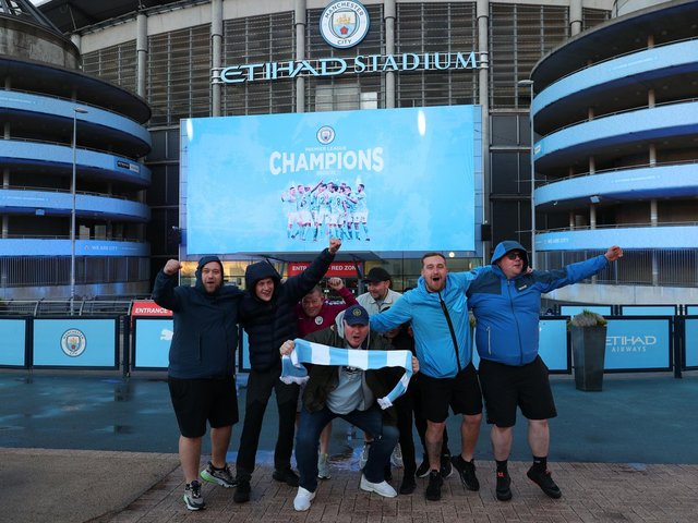 Manchester City fans celebrate at the Etihad Stadium, after Manchester City were crowned Premier League champions following Manchester United's home defeat to Leicester