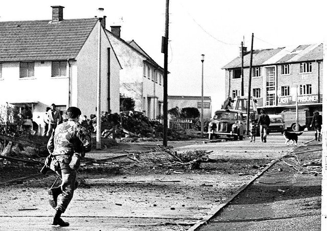 A soldier on the scene of a booby-trap explosion in Ballymurphy, 14/10/82