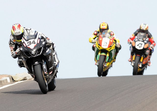 Alastair Seeley (Relentless Suzuki) leads Stuart Easton (Swan Honda) and John McGuinness (HM Plant Honda) over Black Hill on his way to victory in the feature race at the North West 200 in 2010.