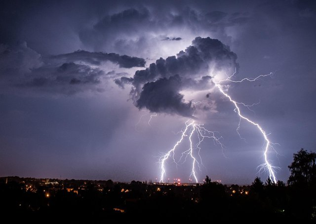 Lightning strikes from a cloud during a thunderstorm