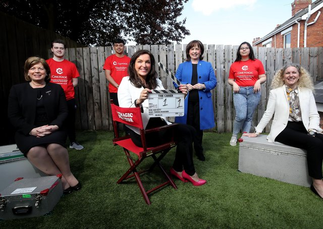 Pictured with Economy Minister Diane Dodds, in Belfast, on the set of Cinemagic film 'The Carer' are filmmaking trainees (Back row L-R) Tom Greer from Carrickfergus, Jac Grogan from West Belfast, Grace Hynds from Portadown,(Front row L-R) North West Regional College Head of Curriculum and Operations, Dr Catherine O'Mullan, Cinemagic CEO, Joan Burney Keatings and Belfast Metropolitan College Chief Executive, Louise Warde Hunter
