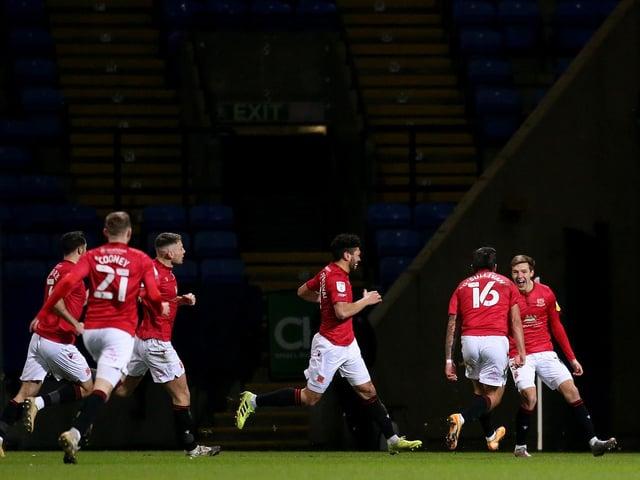 Brad Lyons (far right) celebrates scoring for Morecambe against Bolton