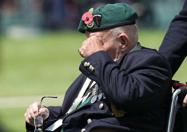 A D-Day veteran wipes his eyes during a Royal British Legion's Service of Remembrance.