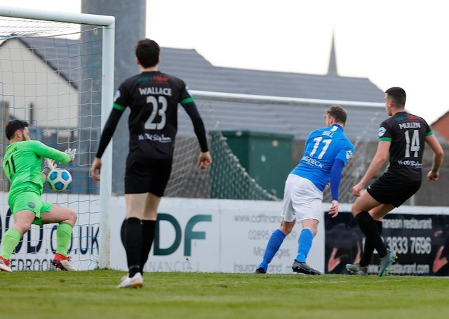 Andy Hall kicks off the scoring for Glenavon in last night's defeat of Warrenpoint Town. Pic by Pacemaker.