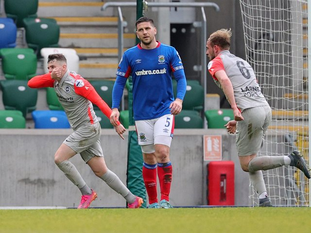 Ronan Hale wheels away in celebration after putting Larne ahead against Linfield
