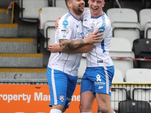 James McLaughlin celebrates his goal with Matthew Shevlin