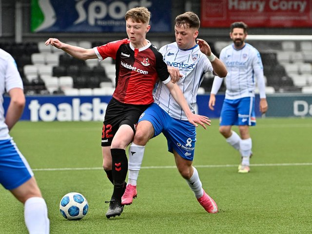 Crusaders' Jack Patterson tussles with Ben Doherty of Coleraine