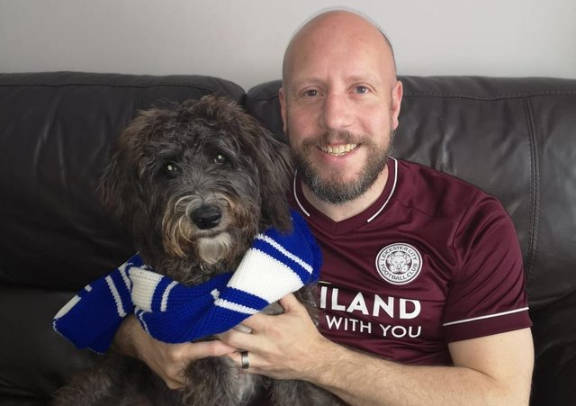 News Letter journalist Graeme Cousins with the latest recruit to the Northern Ireland Leicester City fan club - his dog Shadow