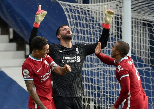 Liverpool goalkeeper Alisson Becker pays a special tribute to his late father. Pic by PA.