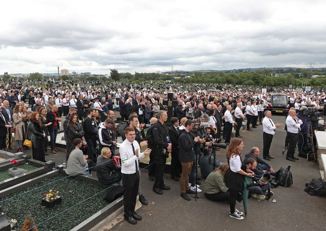 """A crowd listens to Gerry Adams of Sinn Fein speak at the funeral of the IRA man Bobby Storey at Milltown Cemetery in west Belfast last June. """"The fact remains that breaches of the regulations took place at the funeral,"""" writes Mervyn Storey. Photo: Liam McBurney/PA"""