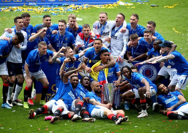 Rangers players celebrate following Saturday's Scottish Premiership trophy presentation. Pic by PA.
