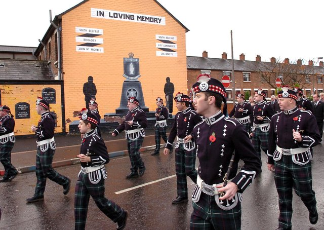 A flute band marches past a UDA mural at a Remembrance Day ceremony in Sandy Row, Belfast, in May 2007. Picture: Justin Kernoghan/Photopress Belfast