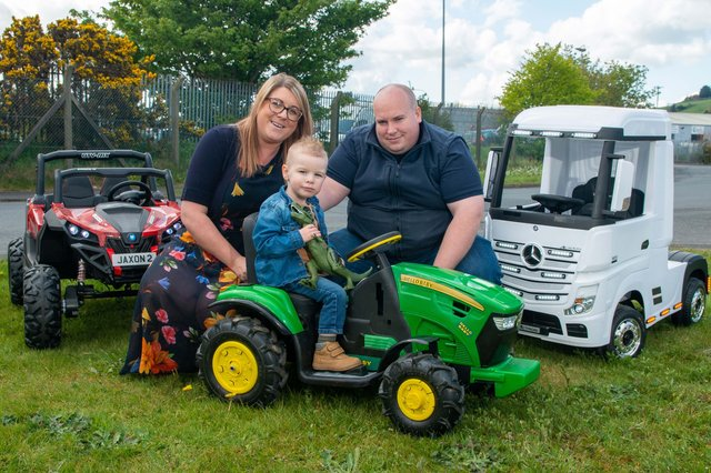 Andrew and Danielle Mitchell, owners of Wee Wheels Ride On Cars with young Jaxon