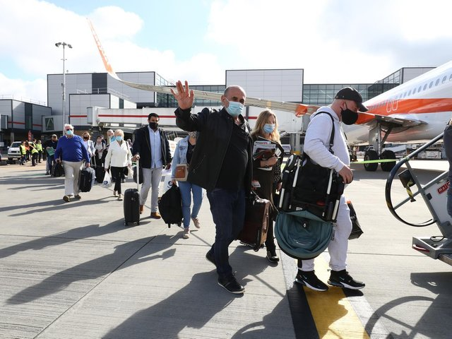 Holidaymakers boarding and EasyJet aircraft bound for Portugal.