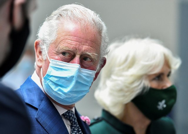 The Prince of Wales and the Duchess of Cornwall during a visit to the Education Authority Headquarters in Belfast.