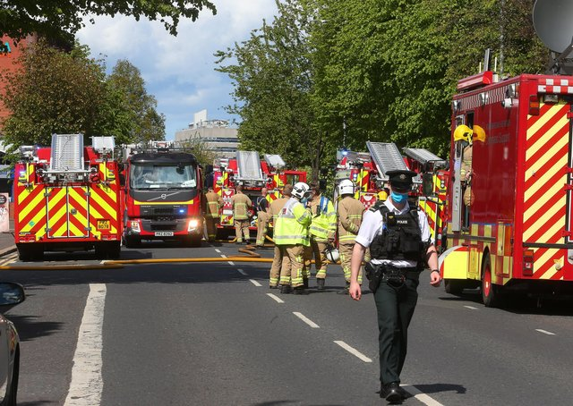 Police have closed a section of Lisburn Road while firefighters tackle a large fire at a three-storey building.The South Belfast road has been closed between Windsor Road and Ethel Street