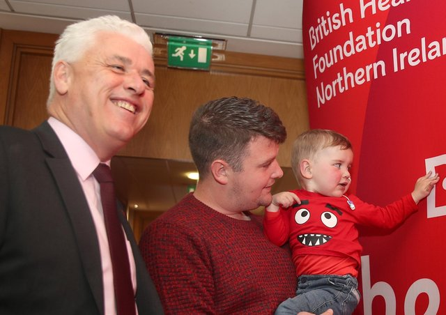 Chief Executive of BHF NI Fergal McKinney with Mairtin MacGabhawn and his four-year-old son Daithi, who urgently needs a heart transplant. Photo: Press Eye.