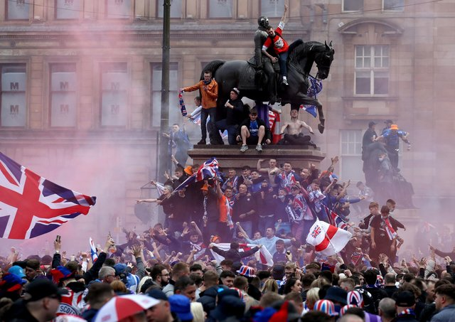 Rangers fans celebrate winning the Scottish Premiership in George Square. Photo: Andrew Milligan/PA Wire.