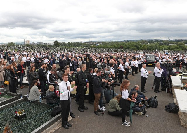 A crowd listens to former Sinn Fein president Gerry Adams speak during the funeral of senior Irish Republican and former leading IRA figure Bobby Storey at Milltown Cemetery in west Belfast. PA Photo. Picture date: Tuesday June 30, 2020. See PA story FUNERAL Storey Photo credit should read: Liam McBurney/PA Wire