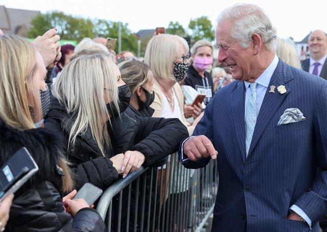 The Prince of Wales during a visit to Bangor Market where he walked around and meeting stall holders at the open-air market. Picture date: Wednesday May 19, 2021