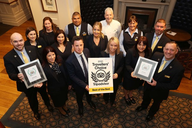Staff and management at Bishop's Gate Hotel with the TripAdvisor Travellers' Choice Award