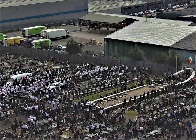 Aerial footage of mourners in Milltown listening to a Sinn Fein oration