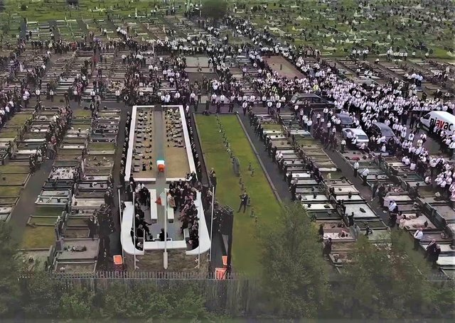 Aerial view of mourners in Milltown Cemetery