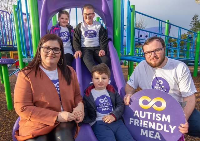 Matthew Armstrong, who sits on Mid and East Antrim Council's Autism Steering Group, with wife Nicola, and children Ollie, Macie and Caleb (centre)