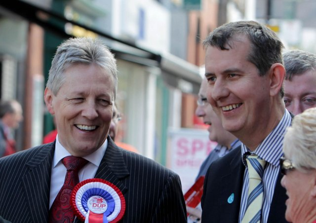 Former DUP leader Peter Robinson (left) said leader elect Edwin Poots (right) 'will not unite unionism if he cannot unite his own party'.  The two men are seen here together on the election trail in Lisburn in 2011. Photo: Presseye.com.