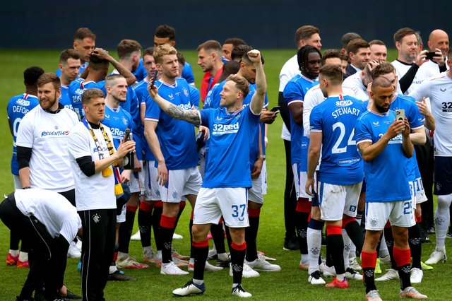 Rangers players celebrate on the pitch after winning the Scottish Premiership; no criminality was found by police