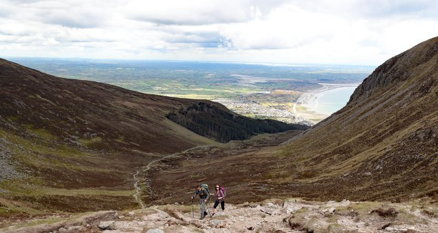 Walkers use the National Trust stone path on Slieve Donard mountain in Newcastle Co Down. Picture date: Friday May 21, 2021.