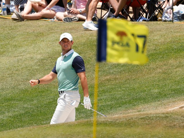 Rory McIlroy watches his shot on the 17th green