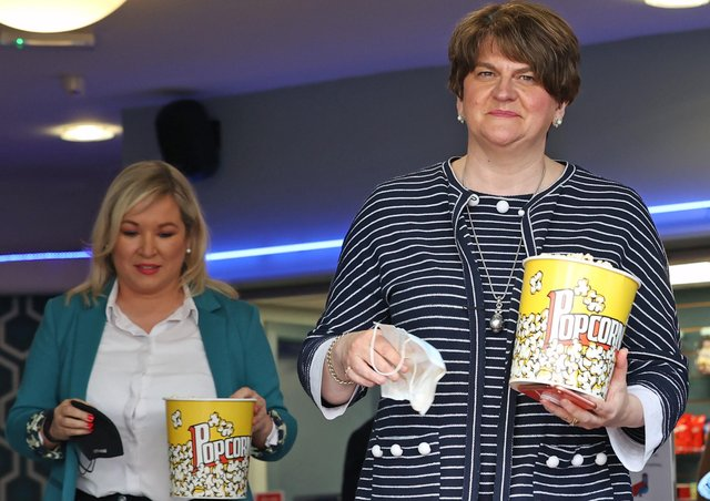 First Minister Arlene Foster and Deputy First Minister Michelle O'Neill at the Strand Centre Cinema in east Belfast to mark the reopening of indoor arts venues, after the latest easing of the Covid-19 rules in Northern Ireland . PA Photo. Picture date: Monday May 24 2021. See PA story ULSTER Coronavirus. Photo credit should read: Liam McBurney/PA Wire