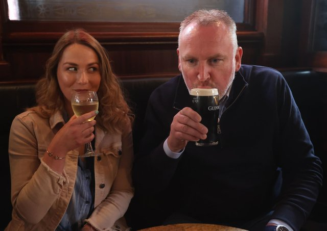 Natalie Knox and Campbell Brady enjoy a drink at The Garrick Bar in Belfast, after the latest easing of the Covid-19 rules in Northern Ireland .Photo: Liam McBurney/PA Wire