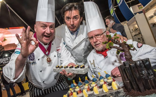 Pictured at the opening of IFEX 2018 are Sean Owens, Director of Salon Culinaire at IFEX, with Jean-Christophe Novelli and patisserie judge, David Close