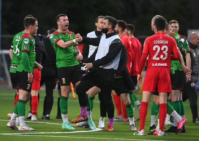 Glentoran celebrate after victory at Larne secured European football for the Oval side.