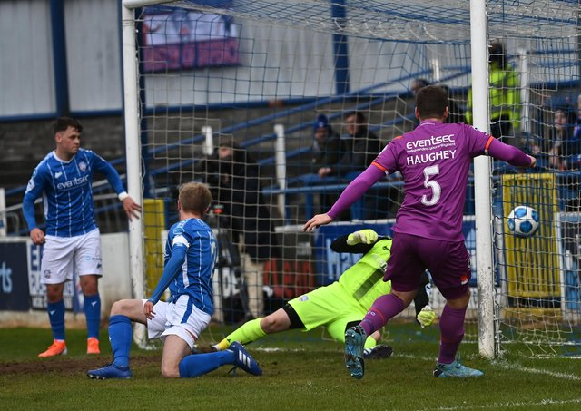 Mark Haughey opens the scoring for Linfield against Coleraine in the Premiership top-of-the-table clash. Pic by Pacemaker.