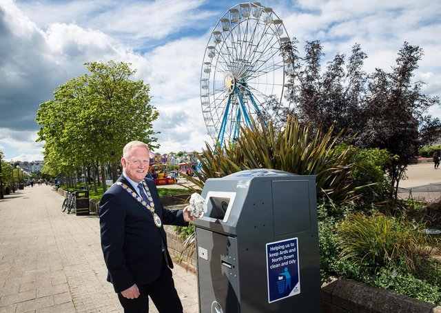 Mayor Trevor Cummings with one of the new solar-powered compacting bins in Bangor. (Image: Graham Baalham-Curry)
