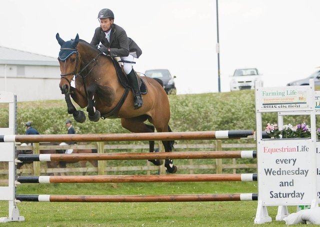 Philip Gaw and Porsch's Diamond with room to spare. A clear round in 51.00 secs secured second place in the 1.20m feature event at Causeway Coast Community Showjumpers in May 2011. Picture: Derek Simpson/Farming Life archives