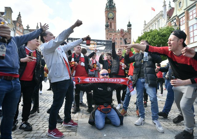 Manchester United fans are seen around the city of Gdansk before the UEFA Europa League final, at Gdansk Stadium, Poland, on Wednesday.