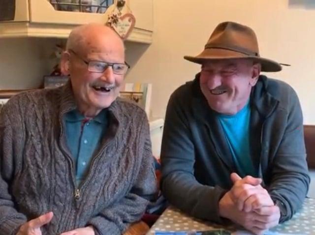Jackie Graham (left) and son Sammy, both mechanics for legendary Ulster road racer Joey Dunlop.  Image capture: Gavan Caldwell.