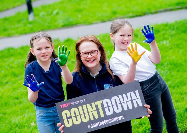 RSPB NI's Sara McCracken is photographed with her daughters Maisie and Isobel as they 'canvas' for nature by illustrating a nature rich and climate safe future they want to see for Northern Ireland, as part of the charity's Revive Our World campaign