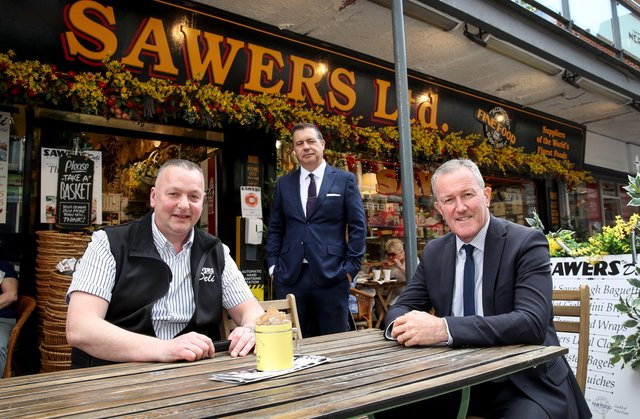 Finance Minister, Conor Murphy picture with Glyn Roberts Chief Executive of Retail NI and  Kieran Sloan, Managing Director of Sawers in Belfast which will benefit from a £10,000 top up grant