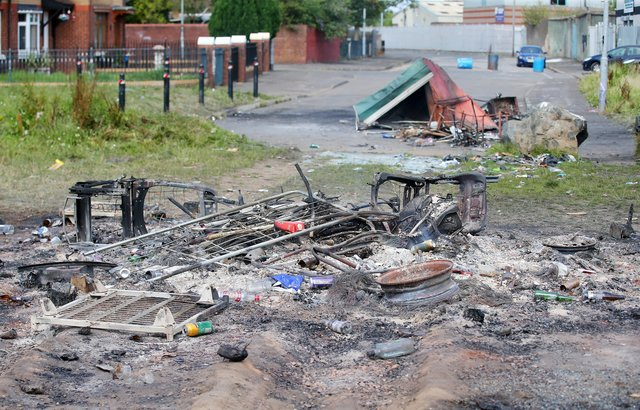The scene at Distillery Street in west Belfast last August after PSNI officers moved in with contractors to remove internment bonfire material.  26 officers were injured after they were attacked by rioters. Picture by Jonathan Porter/PressEye