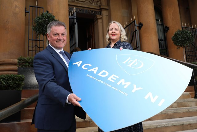 IoD NI Chairman Gordon Milligan and National Director Kirsty McManus mark the return of 'face-to-face' tuition at the IoD Academy with the organisation set to offer it professional development courses in person once again from The Merchant, Belfast